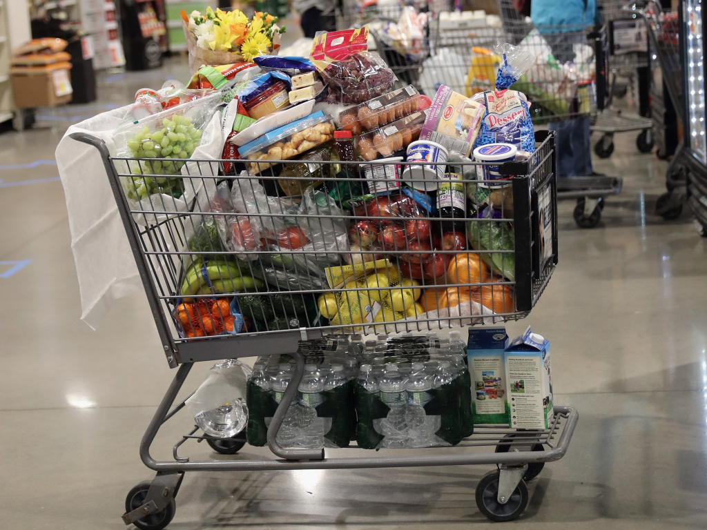 A shopper's full cart is placed on the checkout line at the ShopRite supermarket on April 3, 2020 in Plainview, N.Y. A year later, prices for most goods have jumped, according to government data on Wednesday, as companies struggle to secure critical raw materials amid supply constraints.