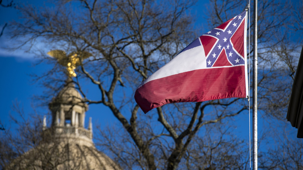 The flag of the state of Mississippi flies in front of the Mississippi State Capitol dome on Jan. 10, 2019. Lawmakers have cleared the way for legislation to remove and replace the flag.