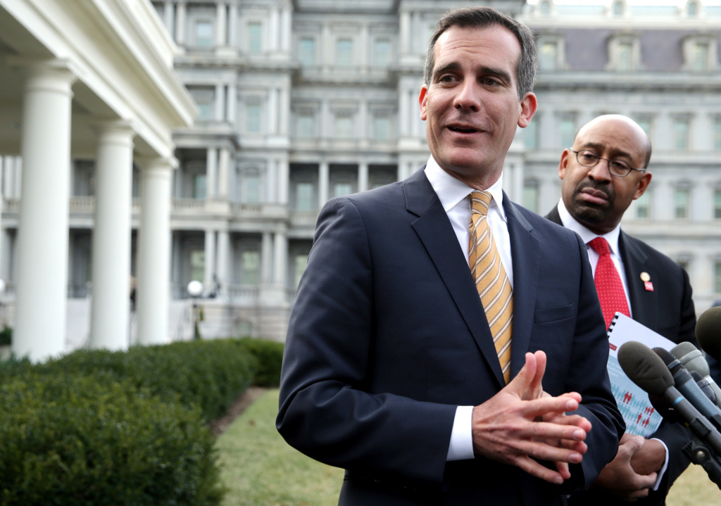 Mayor of Philadelphia Michael Nutter (R) and Los Angeles Mayor Eric Garcetti (L) speak to members of the media.
