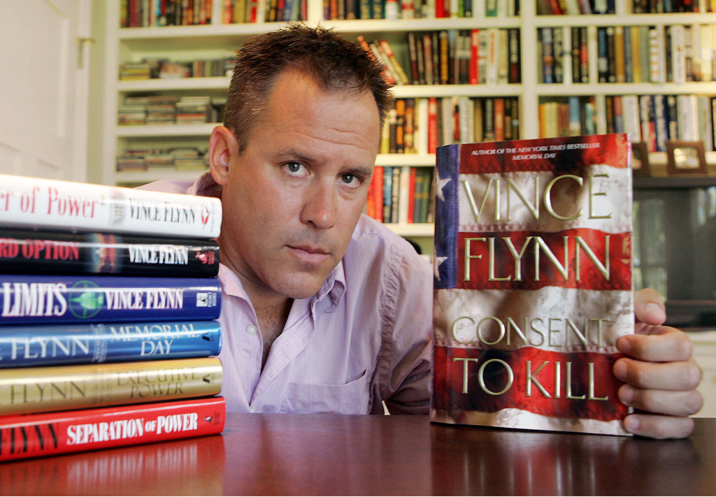 In a Sept. 2, 2005 file photo, best-selling author Vince Flynn poses with the dust jacket of his new book,