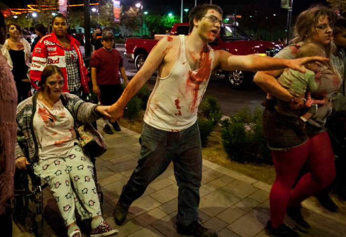 Milania and Beverly Halabi, center, begin a Zombie Walk along Lancaster Boulevard on Friday night.