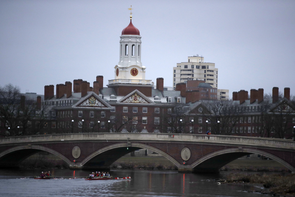 Rowers paddle down the Charles River near Harvard University in Cambridge, Mass., on March 7, 2017.
