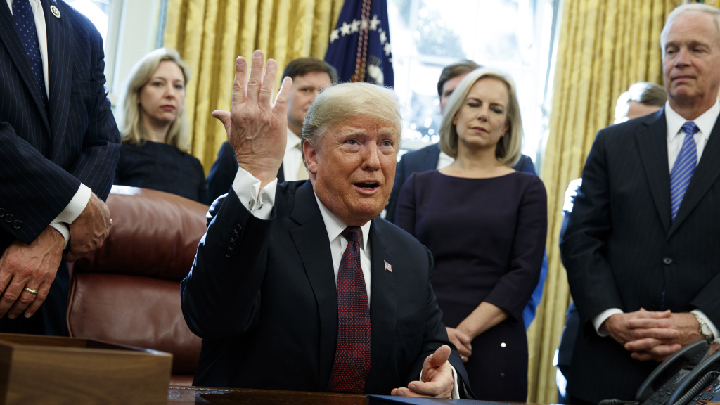 President Trump answers a reporter's question about special counsel Robert Mueller's investigation during a bill signing ceremony Friday in the Oval Office.