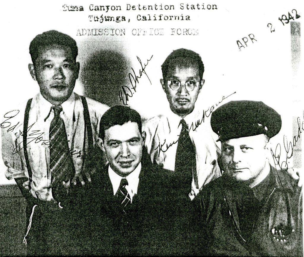 The staff of the admissions office at Tuna Canyon Detention Center poses for a photo. From left to right, Ed S. Yoshimura, Eh Shafer, Keuja Nakane and J.E. Gaddeu.