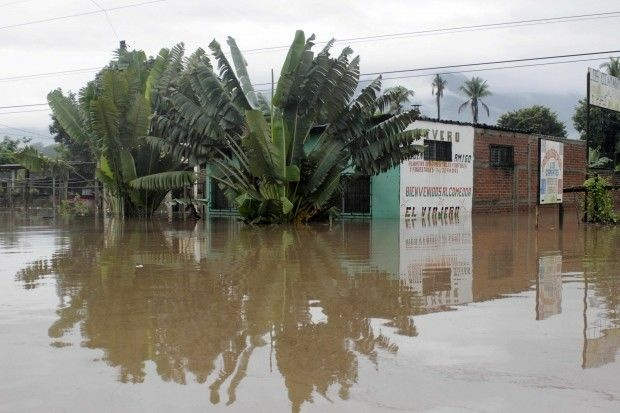 View of a flooded road in Ciudad Arce, El Salvador, October 16, 2011