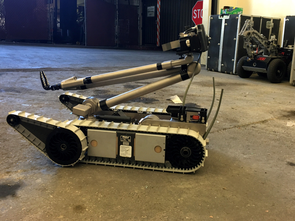 The iRobot PackBot at the West Covina Police Department, obtained through the Department of Defense's 1033 Program. In the background is the WCPD's 'Bulldog' robot.