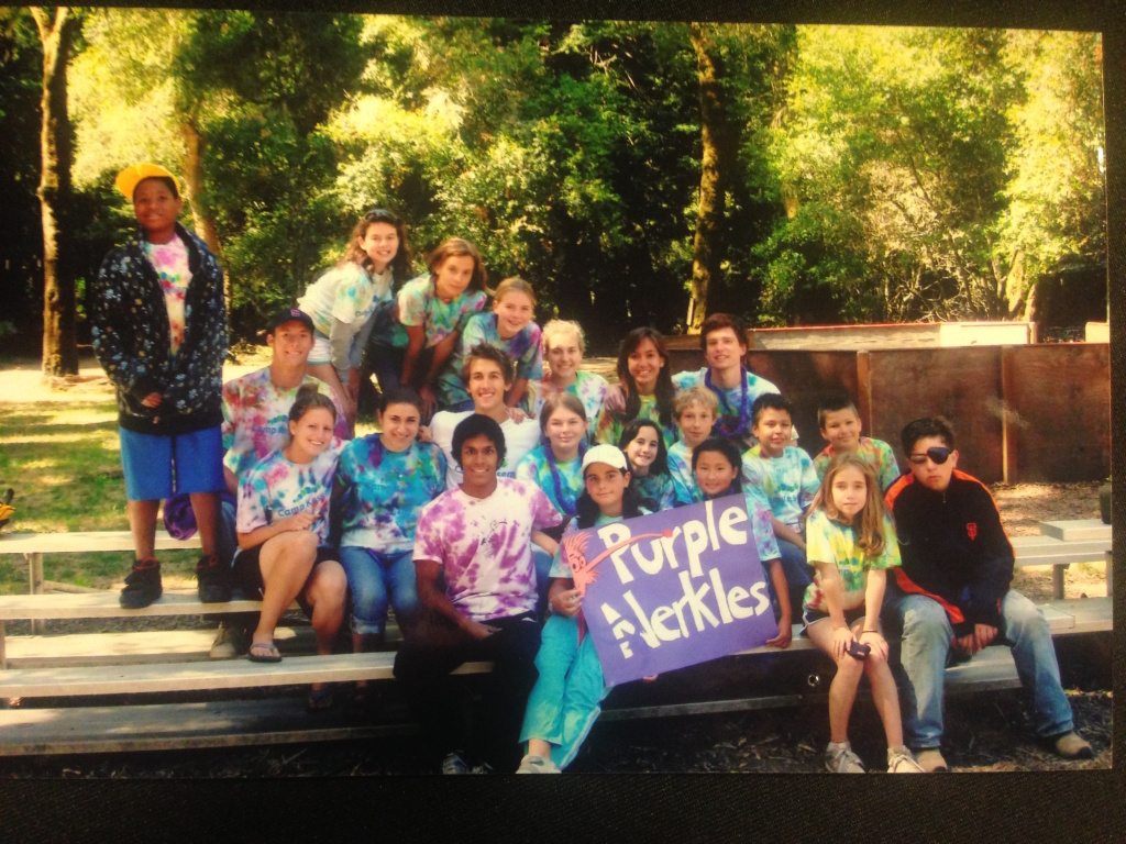 Claire Witzke (behind the purple sign in braids) as a camper at Stanford University's Camp Kesem 2007.