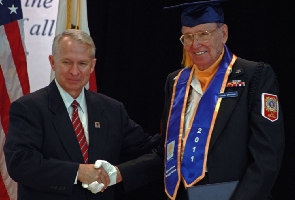 Claude Chastain Jr. of Hemet (R) who served in the U.S. Navy during World War II receives his high school diploma from Riverside County Superintendent of Schools Kenneth M. Young at the annual Operation Recognition ceremony in Moreno Valley.
