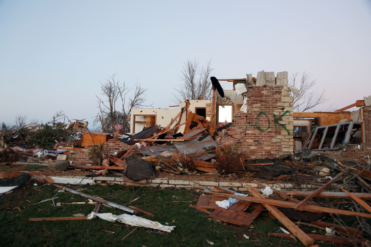 A firefighter searches through debris after a tornado struck on November 17, 2013 in Washington, Illinois. Several tornadoes touched down across the Midwest today with at least three people reported dead in Illinois.
