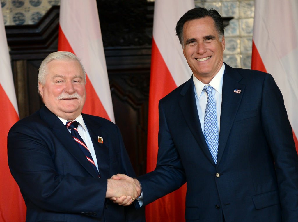 Republican presidential candidate and former Governor of Massachusetts Mitt Romney (R) shakes the hand of former Polish President and Nobel Peace Prize winner Lech Walesa, during a meeting at Artus Court, in Gdansk, on 30, 2012. White House hopeful Mitt Romney is to hold talks with Poland's Prime Minister Donald Tusk and the anti-communist icon Lech Walesa, as he makes his first venture beyond the old iron curtain. On the final leg of a three-stop tour designed to burnish his foreign policy credentials, the Republican contender has chosen to visit a country which has notably testy relations with Russia and is now a key pillar of NATO and the EU.