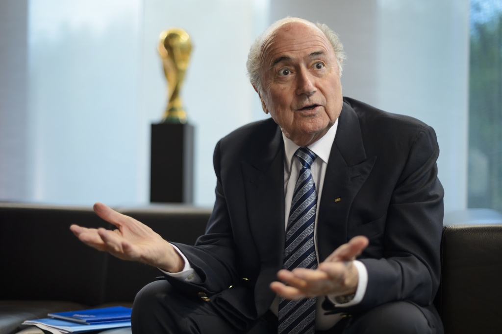 President of International governing body of association football FIFA Sepp Blatter gestures during an interview on May 15, 2015 at the of organization's headquarters  in Zurich.