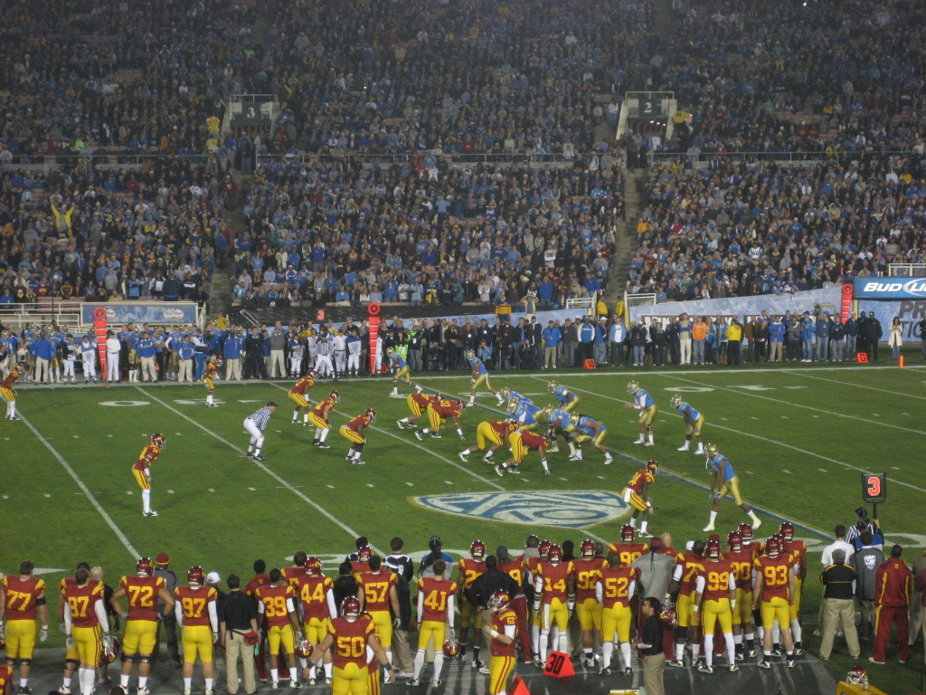 UCLA and USC play at the Rose Bowl in the final home game of 2011. ESPN has agreed to pay a whopping average of $80 million a year to continue televising the annual Rose Bowl college football game.