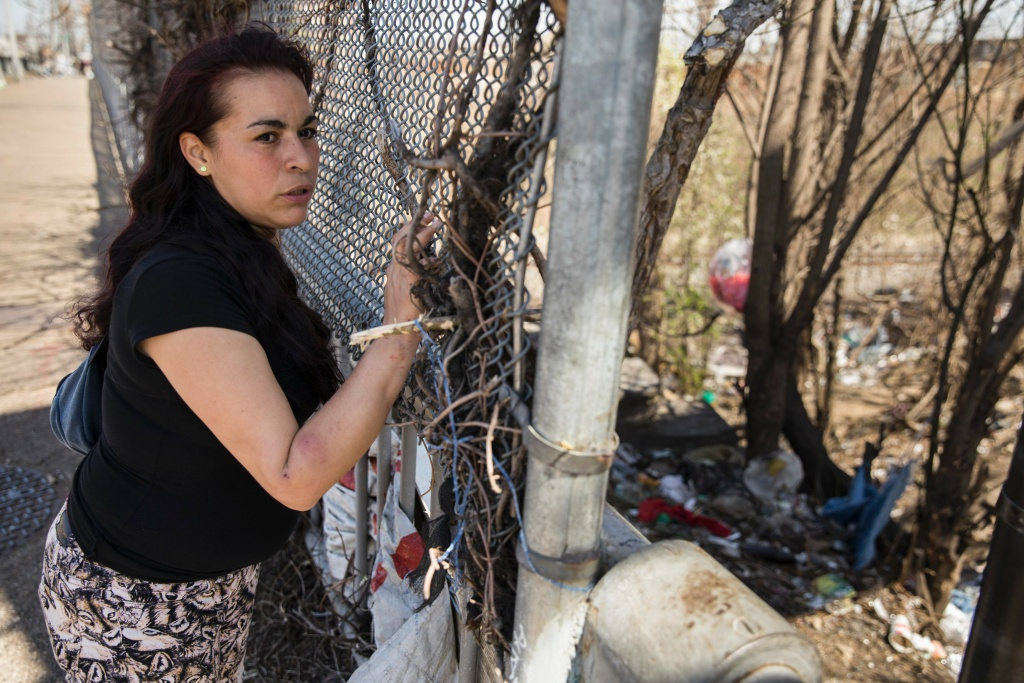Jessica, a homeless addict, looks down at the heroin encampment where she typically lives in the Kensington neighborhood of Philadelphia, Pennsylvania, on April 10, 2017.