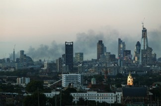 Smoke continues to drift across the London skyline.