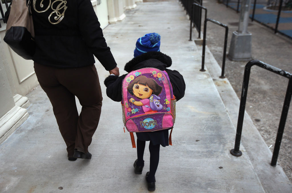 A parent and child arrive to school on November 5, 2012 in the East Village neighborhood of New York, United States.