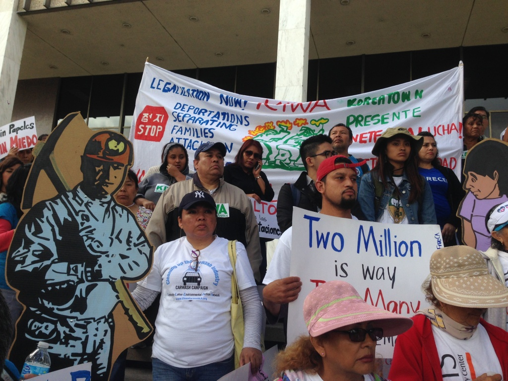 A crowd protests deportations during a recent rally in Los Angeles. A growing number of local governments are making their own decisions about carrying out federal immigration holds, opting to set limits on who they hand over to immigration authorities.