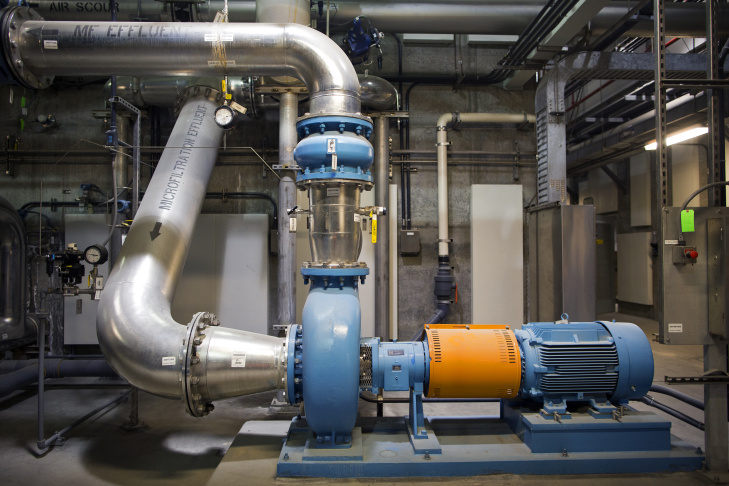 Giant pipes carry sewage water to be filtered in the micro-filtration area, the first of three different steps in the water recycling process.