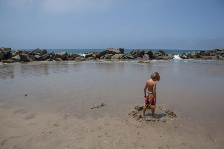 Nine-year-old Jacob Hatch of Los Angeles plays in the sand near the Venice Beach breakwater.