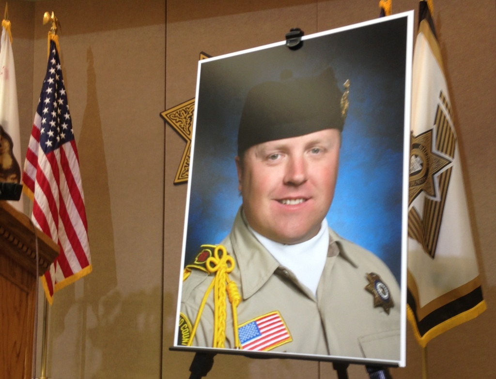 Slain Sheriff's Deputy Jeremiah MacKay, who was allegedly killed in a gunfight with suspected murderer Christopher Dorner. This poster was displayed at a San Bernardino Sheriff's Department press conference.