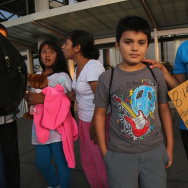 A Salvadoran family waits at a Greyhound bus station for their trip to Houston on July 25, 2014 in McAllen, Texas. After a surge in recent months, the number of unaccompanied minors arriving at the U.S.-Mexico border from Central America has dropped sharply, and emergency shelters set up on military bases have closed for the time being. It's unclear if more child migrants will arrive after the summer.