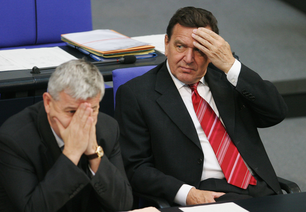 German Chancellor Gerhard Schroeder (R) and German Foreign Minister Joschka Fischer display signs of anxiety during votes at the German parliament (Bundestag) October 17, 2003 in Berlin, Germany.
