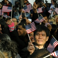 New citizens wave US flags