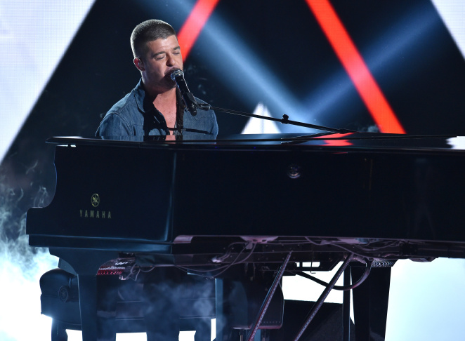 Singer Robin Thicke performs onstage during the BET AWARDS '14 at Nokia Theatre L.A. LIVE on June 29, 2014 in Los Angeles, California. Thicke's new album,