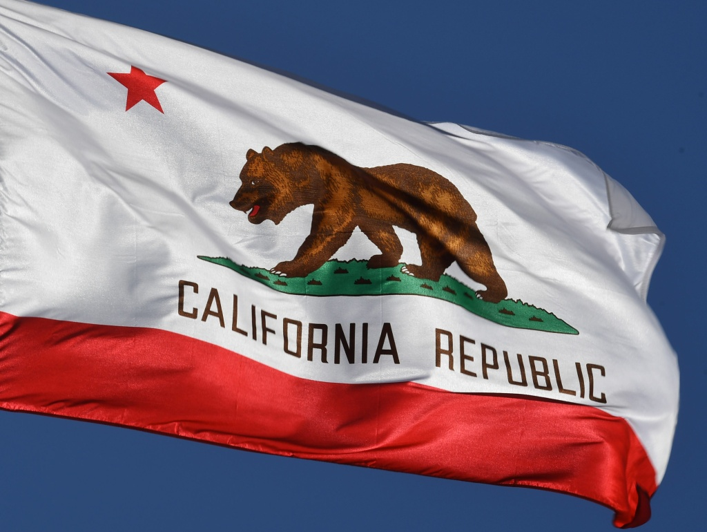 The California State flag flies outside City Hall, in Los Angeles.