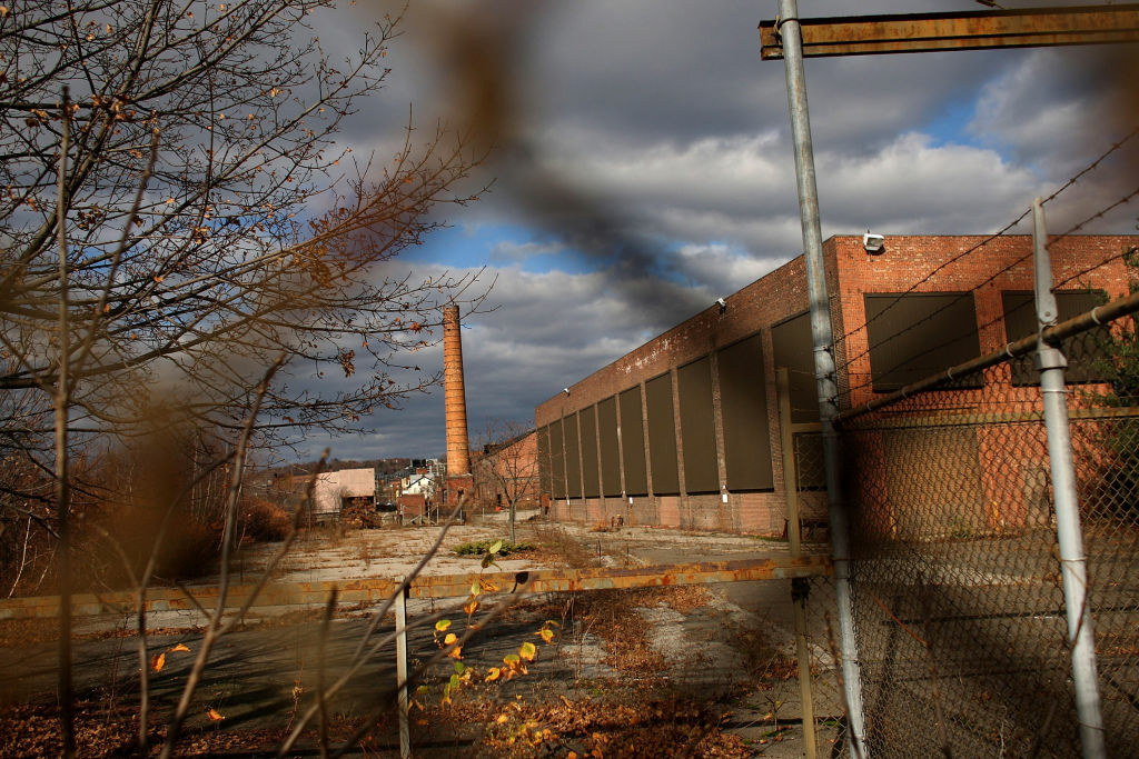 A closed factory sits in Waterbury, Connecticut. The government has revised up U.S. GDP growth numbers for the second quarter, but GDP continues to be weak.