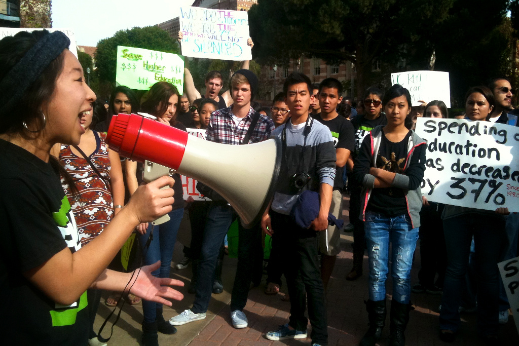 A file photo of UCLA student Kelly Osajima addresses about 200 people at UCLA protesting  tuition increases. Democratic bills to cut college fees have received bipartisan votes, but the companion bills proposed to fund them lack the same support.