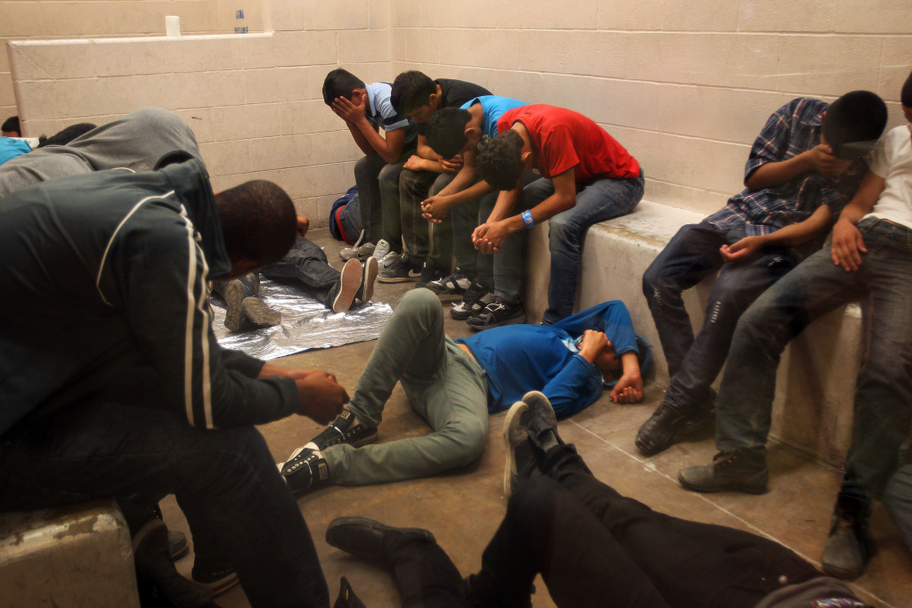 Immigrants caught crossing the Texas border illegally are detained at the McAllen Border Patrol Station this summer.