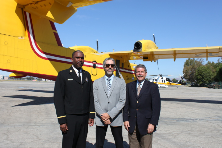 LA County Fire Chief Daryl Osby, Quebec delegue Alain Houde, and LA County Supervisor Zev Yaroslavsky in front of one of the Super Scoopers the county leases from Quebec for fire season. Van Nuys Airport, 9-4-2012.