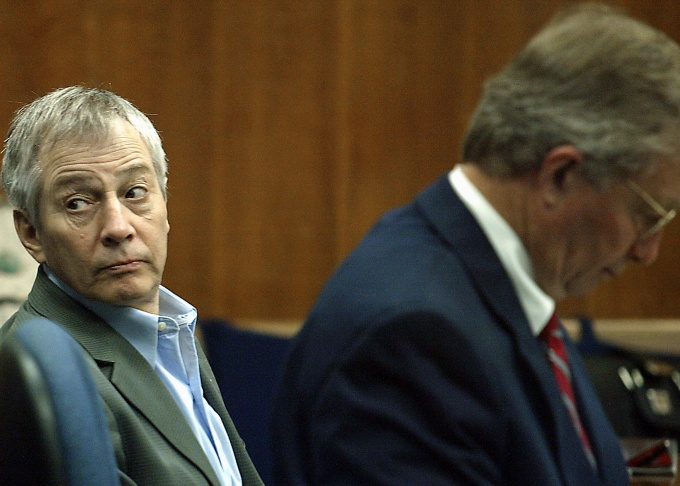 Millionaire murder defendant Robert Durst (C) sits in State District Judge Susan Criss court with his attorney Dick DeGuerin (R) November 10, 2003 at the Galveston County Courthouse in Galveston, Texas. Durst is being charged for the murder and mutilation of his neighbor Morris Black. (