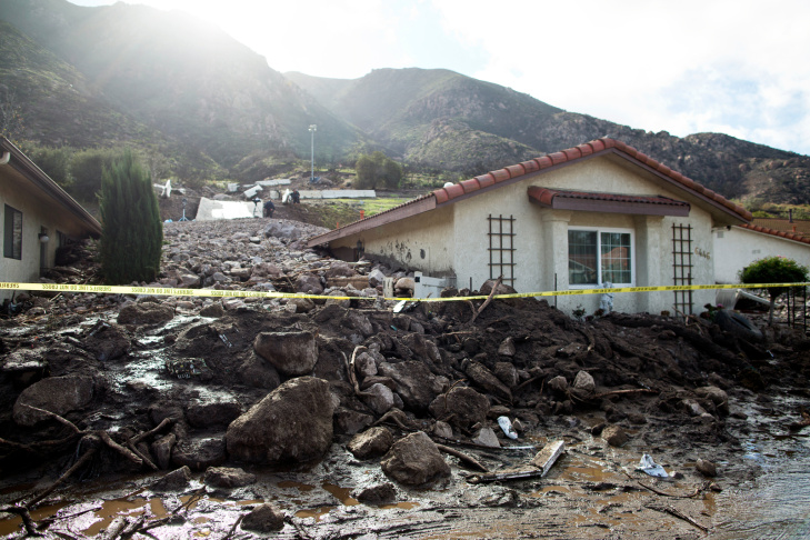 A home damaged by mudslides on Nov. 1, 2014 was buried after an overnight storm caused mudslides in Camarillo Springs on Dec. 12, 2014.