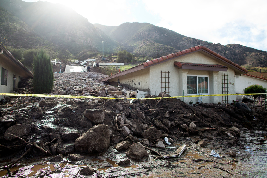 File: A home damaged by mudslides was further buried after an overnight storm caused mudslides in Camarillo Springs in Dec. 2014.