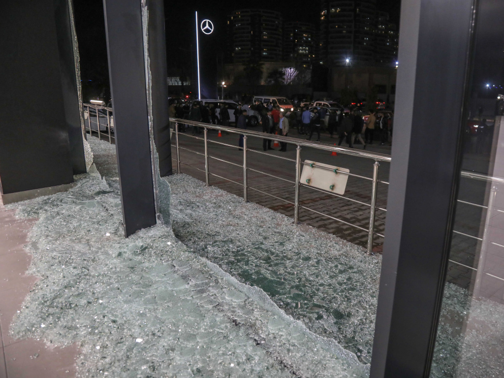Shattered glass is on the ground following a rocket attack in Irbil, the capital of the northern Iraqi Kurdish autonomous region, on Feb. 15. On Thursday, the U.S. launched airstrikes targeting Iranian-backed groups in eastern Syria in response to recent attacks against Americans in Iraq.