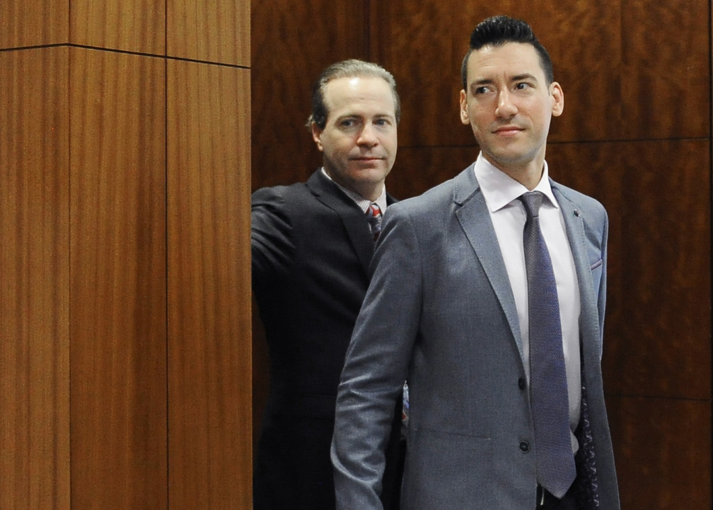 File: In this April 29, 2016 file photo, David Robert Daleiden, right, leaves a courtroom after a hearing in Houston. California prosecutors say two anti-abortion activists who made undercover videos of themselves trying to buy fetal tissue from Planned Parenthood have been charged with 15 felony counts of invasion of privacy. State Attorney General Xavier Becerra announced the charges Tuesday, March 28, 2017, against Daleiden and Sandra Merritt.