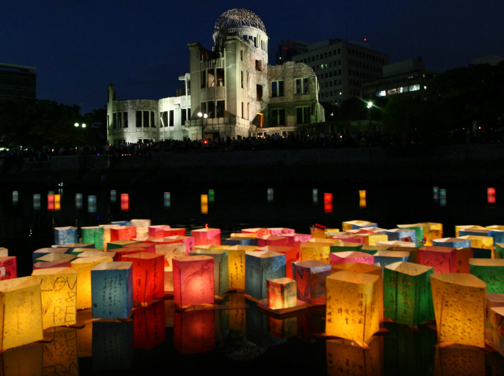 HIROSHIMA, JAPAN - AUGUST 06:  Paper lanterns float on the Motoyasu River in front of the Hiroshima Peace Memorial, commonly called the Atomic Bomb Dome, at the Hiroshima Peace Memorial Park on August 6, 2012 in Hiroshima. Japan. Japan is marking the 67th anniversary of the first atomic bomb dropped on Hiroshima by the United States on August 6, 1945, which killed an estimated 70,000 people instantly and many thousands more over the following years from radiation. Three days later another atomic bomb was dropped on Nagasaki, that effectively ended World War II.  (Photo by Buddhika Weerasinghe/Getty Images)