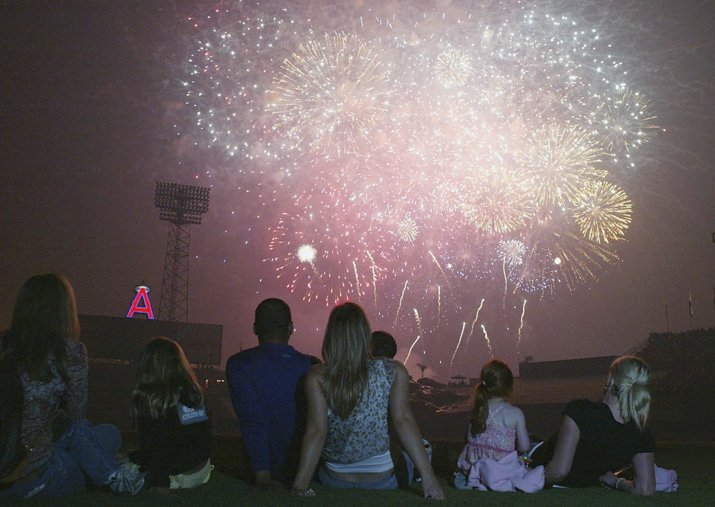 A group of people watche a firework display at Angel Stadium in Anaheim.