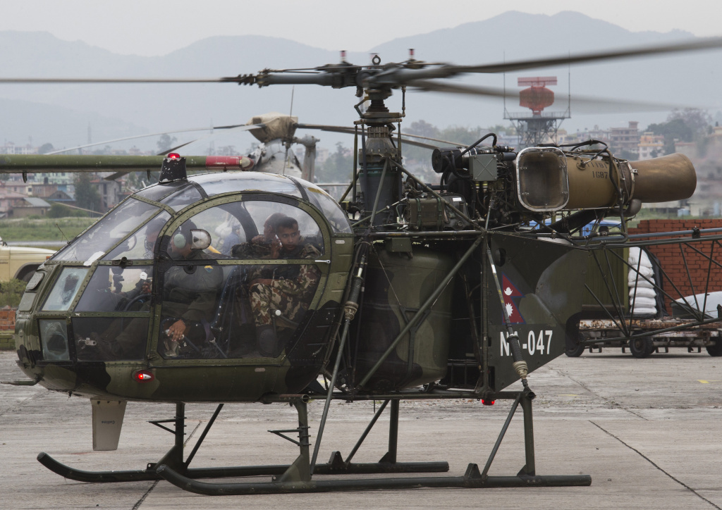 A Nepalese army chopper, which spotted the wreckage of a U.S. Marine helicopter, lands at the airport in Kathmandu, Nepal, on Friday.