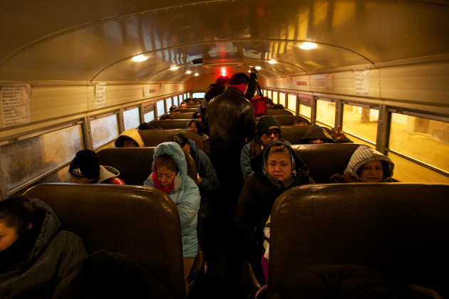 Little Village on Chicago's west side in the early morning hours of Jan. 18, 2013. Workers board a yellow school bus owned by the raitero Rigo.
