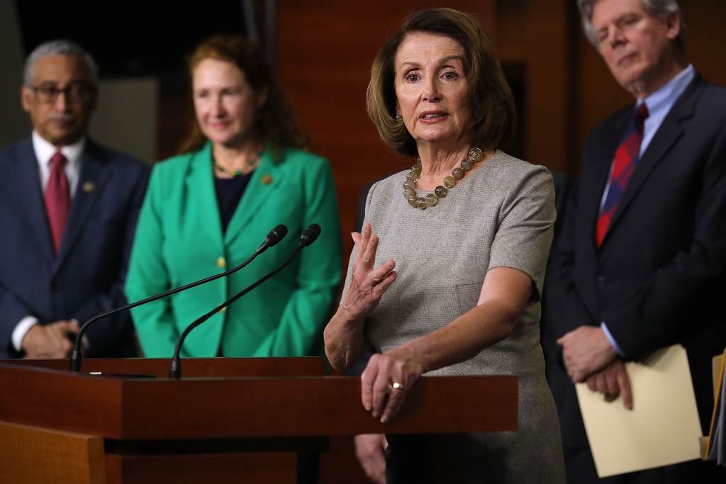 House Minority Leader Nancy Pelosi (D-CA) (3rd L) talks to reporters while announcing the House Democrats' new infrastructure plan during a news conference with (L-R) Rep. Bobby Scott (D-VA), Rep. Elizabeth Esty (D-CT) and Rep. Frank Pallone (D-NJ) at the U.S. Capitol February 8, 2018 in Washington, DC.