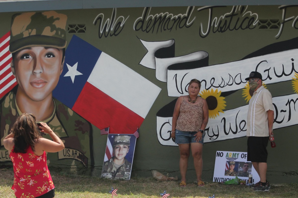 Larissa Martinez of the organization Circle of Arms takes photos at the unveiling of a San Antonio mural. It pays tribute to Vanessa Guillen and Gregory Wedel Morales, two Fort Hood soldiers who were found dead near the base in separate incidents this year.