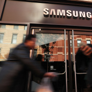 People walk by the new Samsung store in lower Manhattan in this October 11, 2016 file photo taken in New York City. The Supreme Court on Tuesday unanimously backed Samsung in a patent dispute filed by Apple over the design of the two companies' flagship smartphones.