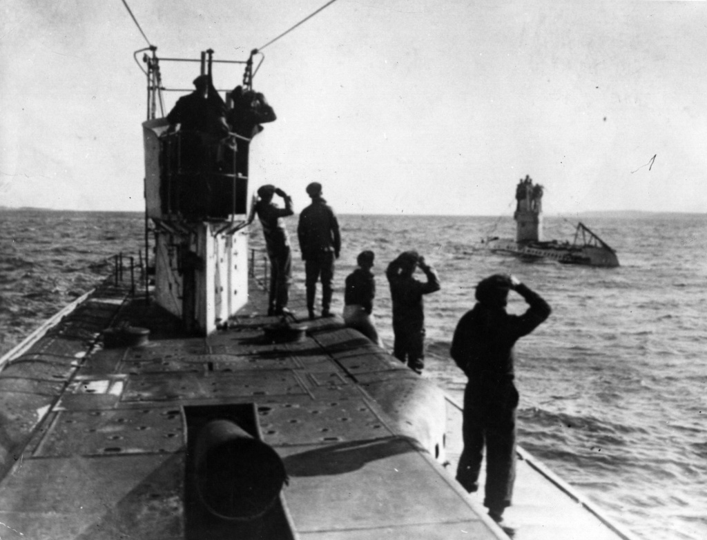 Two German submarines, the U35 and U42, surface off the Mediterranean coast.