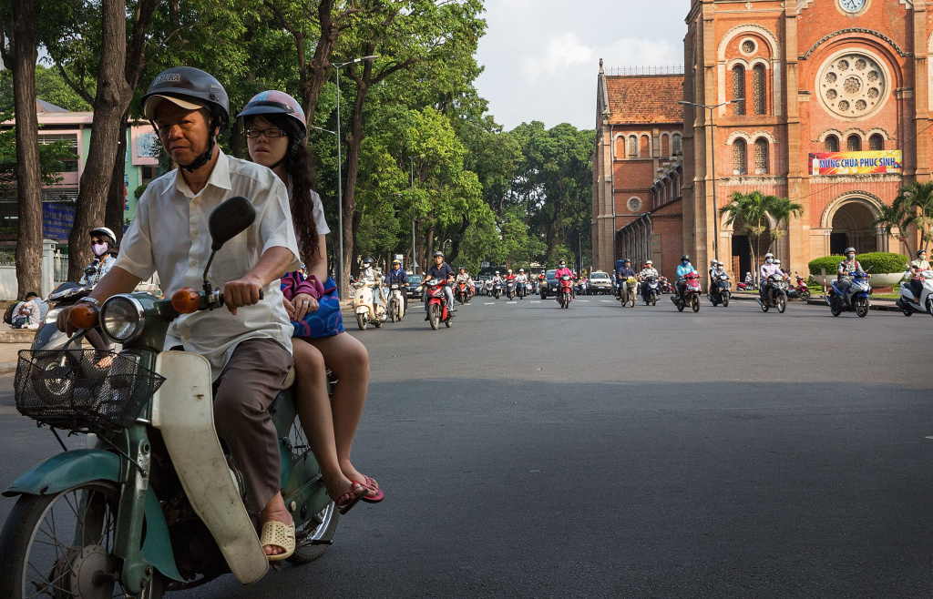 Motorists pass by the Saigon Notre-Dame Basilica on April 21, 2015 in Ho Chi Minh City, Vietnam.  April 30th marks the 40th anniversary of the capture of Saigon by North Vietnamese forces.