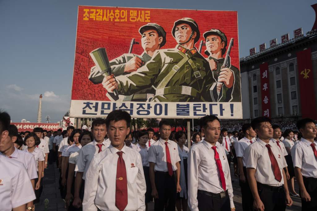 A propaganda poster is diplsyed during a rally in support of North Korea's stance against the US, on Kim Il-Sung square in Pyongyang on August 9, 2017.