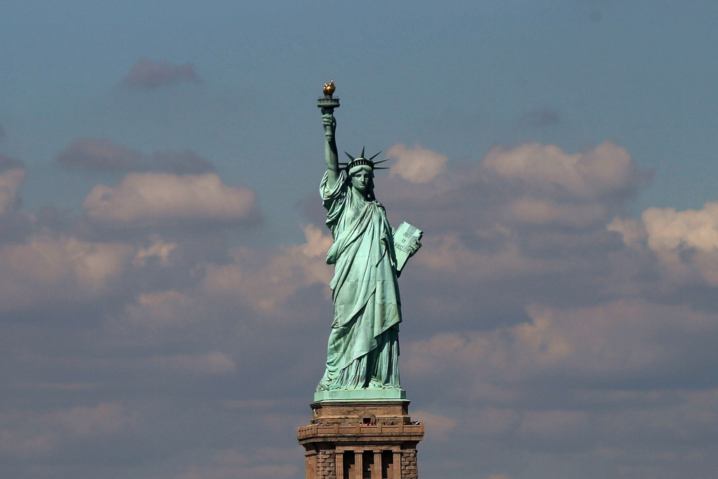 The Statue of Liberty, one of New York's premiere tourist attractions, is viewed from the Staten Island Ferry on September 30, 2013 in New York City.