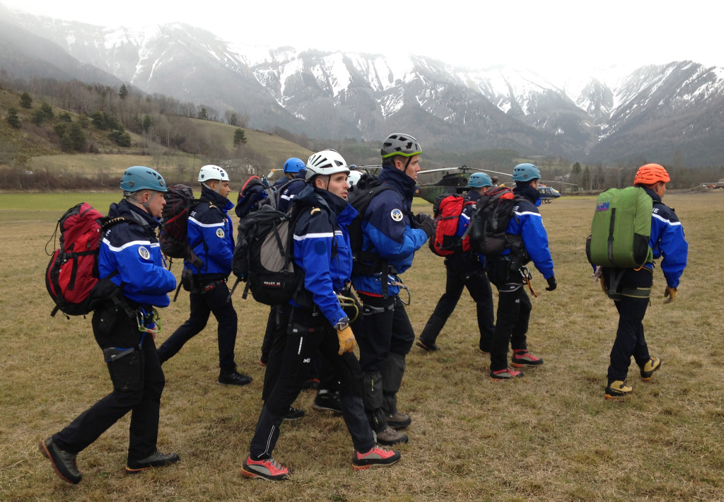Gendarmerie and French mountain rescue teams arrive near the site of the Germanwings plane crash near the French Alps on March 24, 2015 in La Seyne les Alpes, France.  A Germanwings Airbus A320 airliner with 148 people on board has crashed in the French Alps.