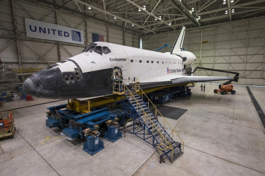The space shuttle Endeavour is seen atop the Over Land Transporter (OLT) in a hanger at Los Angeles International Airport, Monday, Sept. 24, 2012.